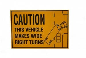 "Why Trucks Have ""Caution: Wide Turn"" Warnings"